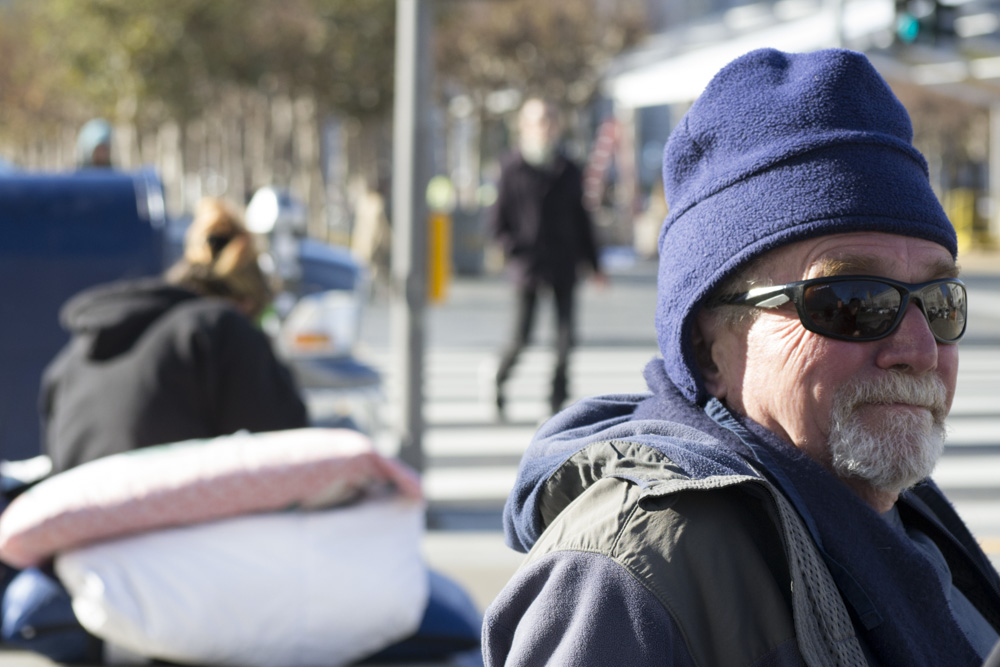 Homeless man at San Francisco's Civic Center, during a cold spell in 2013. (Sara Bloomberg/KQED)