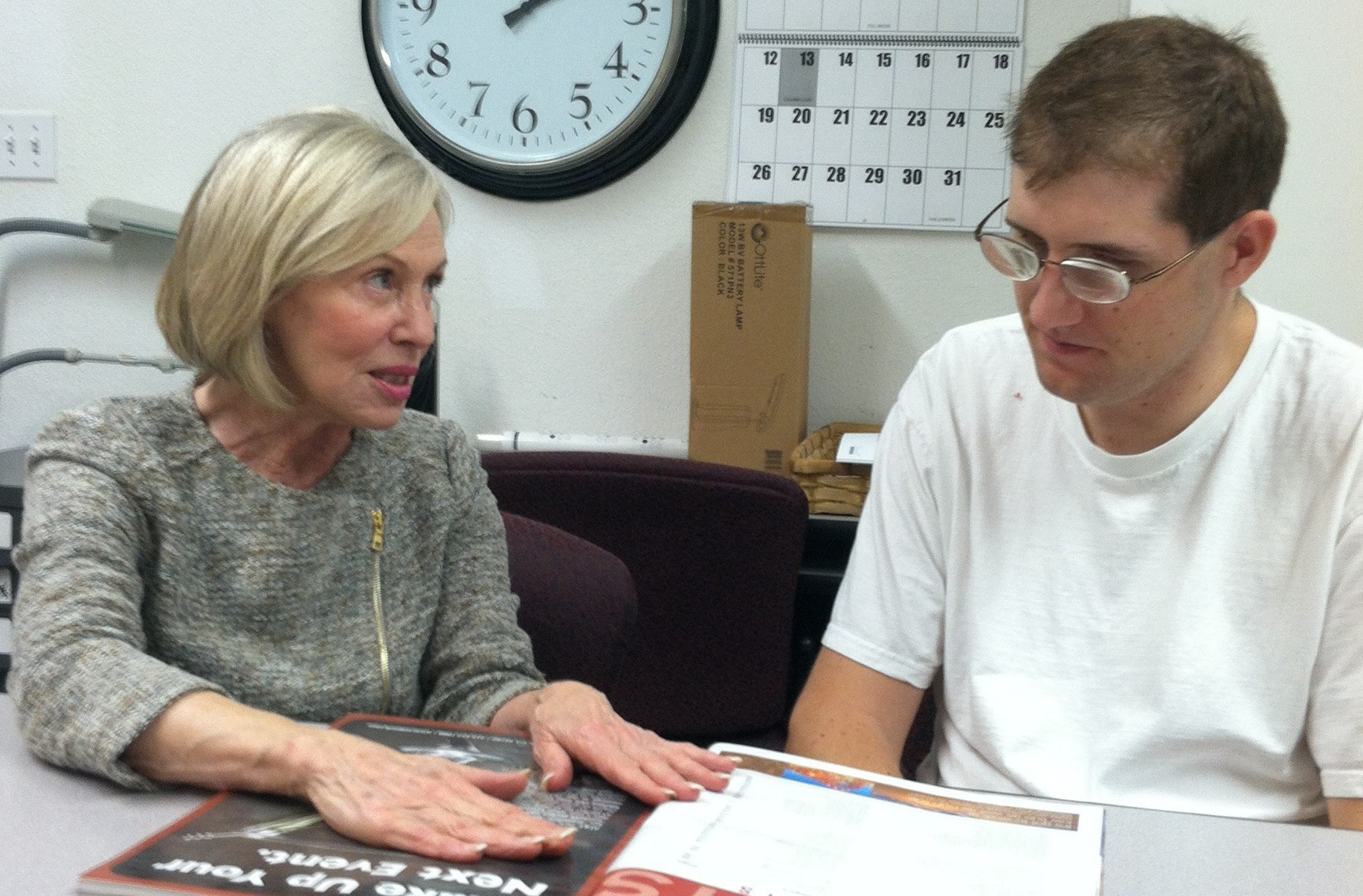Kate Williams of LightHouse for the Blind and Visually Impaired works with client Greg Trela.