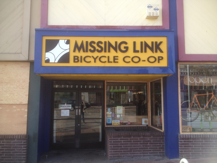 Missing Link bicycle cooperative at 1988 Shattuck Ave. has repaired its two windows that were damaged during protests. A worker there said they don't think they were specifically targeted. Next door, McDonald's is covered in plywood. (Natalie Orenstein/Berkeleyside)