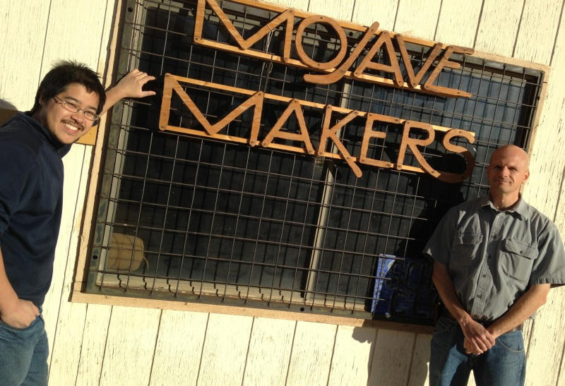 Nathan Chew, left, and Brandon Larson outside the Mojave Makers Space workshop. (Steven Cuevas/KQED)
