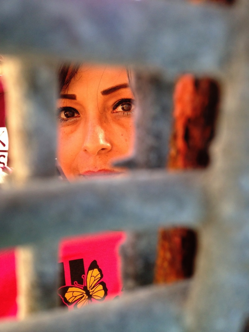 """Yolanda Varona attended La Posada Sin Fronteras on the Tijuana side, where she's lived since having a U.S. tourist visa revoked. One of her grandchildren who lives in the U.S. visited her here at another border event. """"But I didn't like it, she thinks I'm in jail,"""" says Varona. (Courtesy Leslie Berestein Rojas)"""