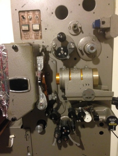 """A film projector at Peter Conheim's """"Small Back Room"""" home movie theater in El Cerrito. (Jon Brooks/KQED)"""