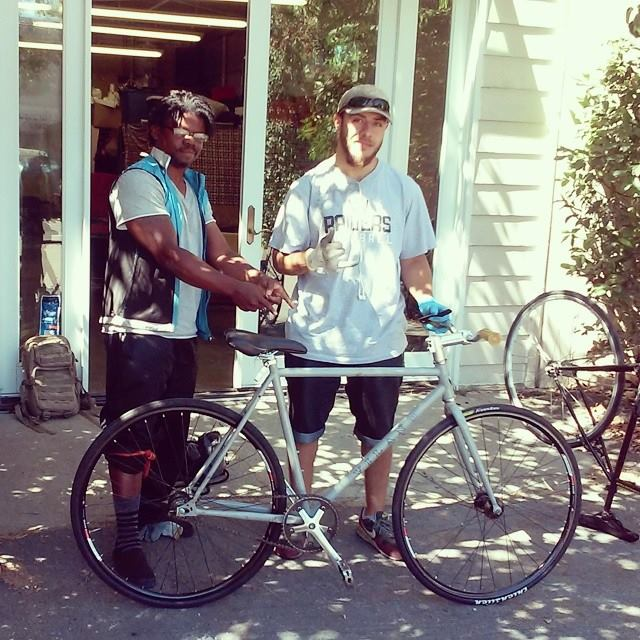 Najari Smith, left, and Jaime Silva, right, with Silva's recovered bike. (Photo courtesy Rich City Rides)
