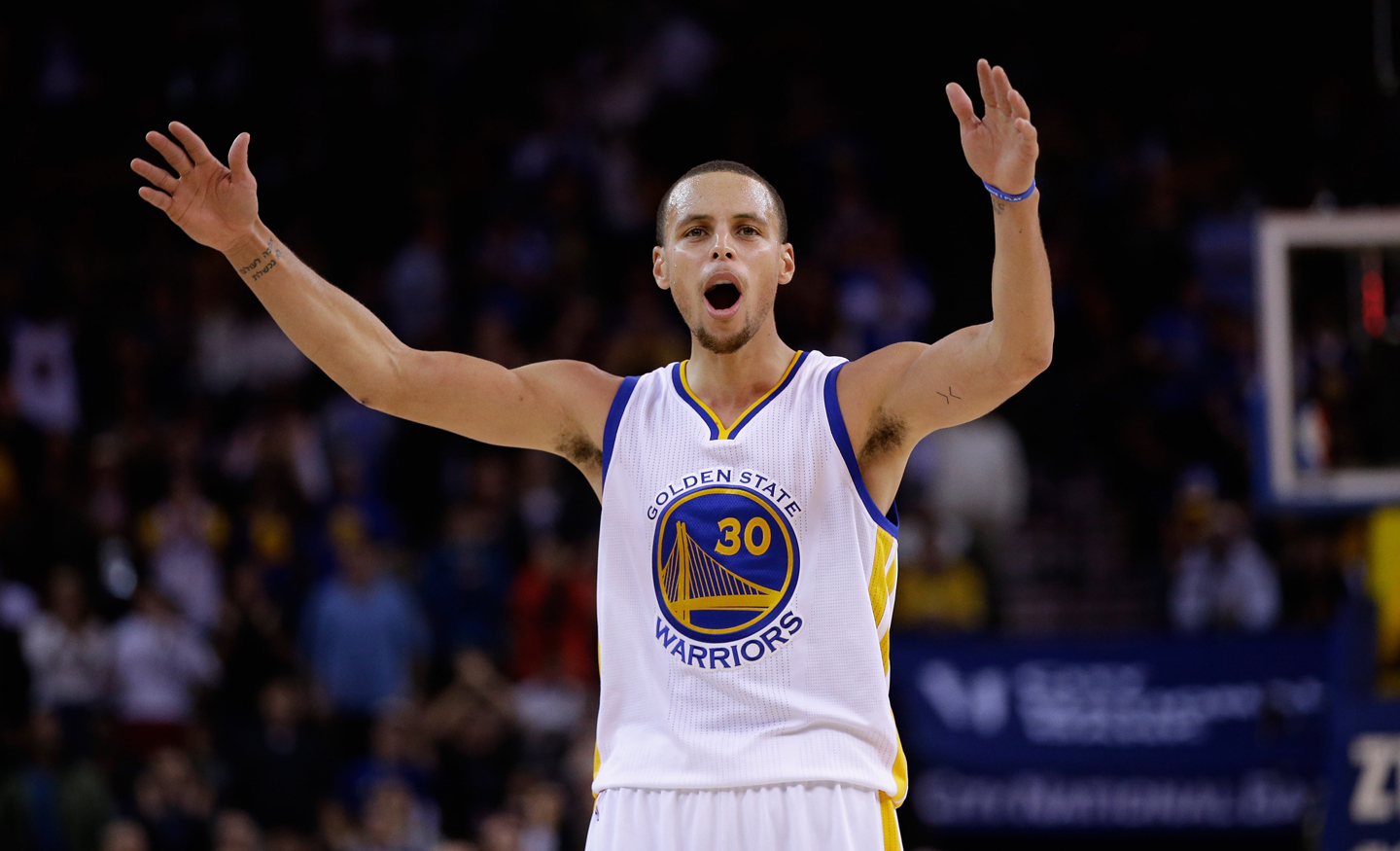 Stephen Curry tries to get the crowd louder during the fourth quarter of their game against the Houston Rockets at ORACLE Arena on December 10, 2014 in Oakland, California. (Ezra Shaw/Getty Images)