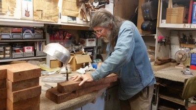 John Jordan works on an electric violin in his Concord studio.