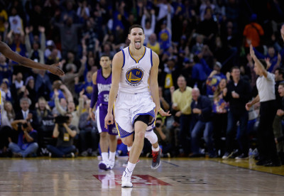 Klay Thompson #11 of the Golden State Warriors reacts after he made a 3-point basket in the third quarter of their game against the Sacramento Kings on Jan. 23, 2015, in Oakland.