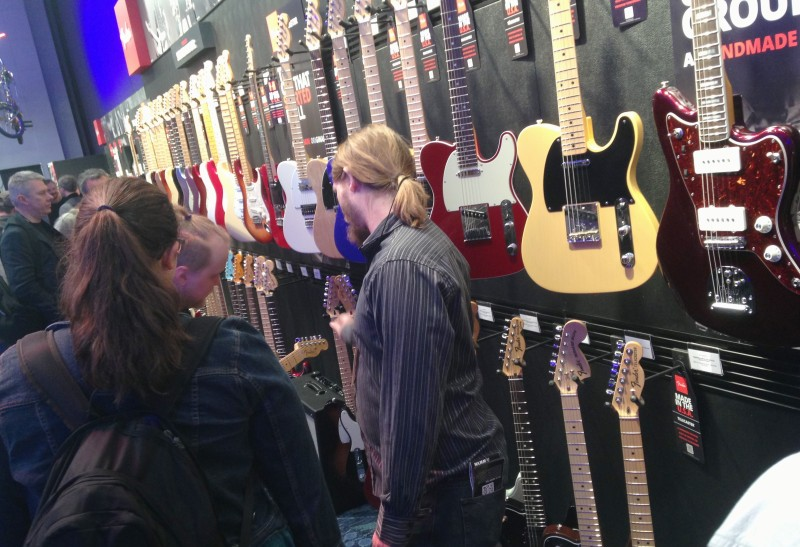 Musicians and merchants check out Fender products at this month's National Association of Music Manufactures convention in Anaheim.