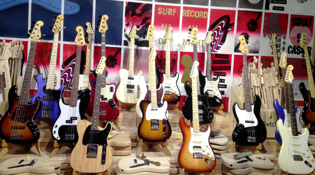 A museum-worthy display shows off some of Fender's signature guitars at a National Association of Music Manufacturers convention.