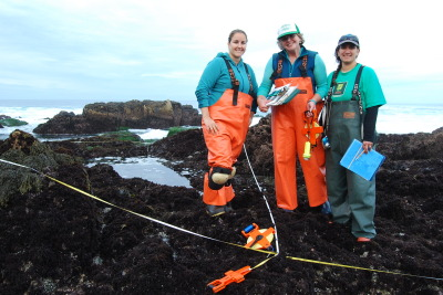 Counting tidepool inhabitants requires specialized equipment: clipboards, flashlights, cloth tape for marking plots and waders. From left, Melissa Redfield, Maya George, Rani Gaddam.