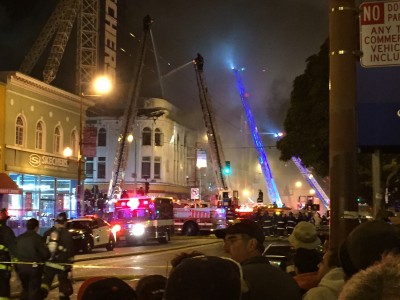 San Francisco firefighters at the scene of a four-alarm blaze Wednesday night at 22nd and Mission streets.
