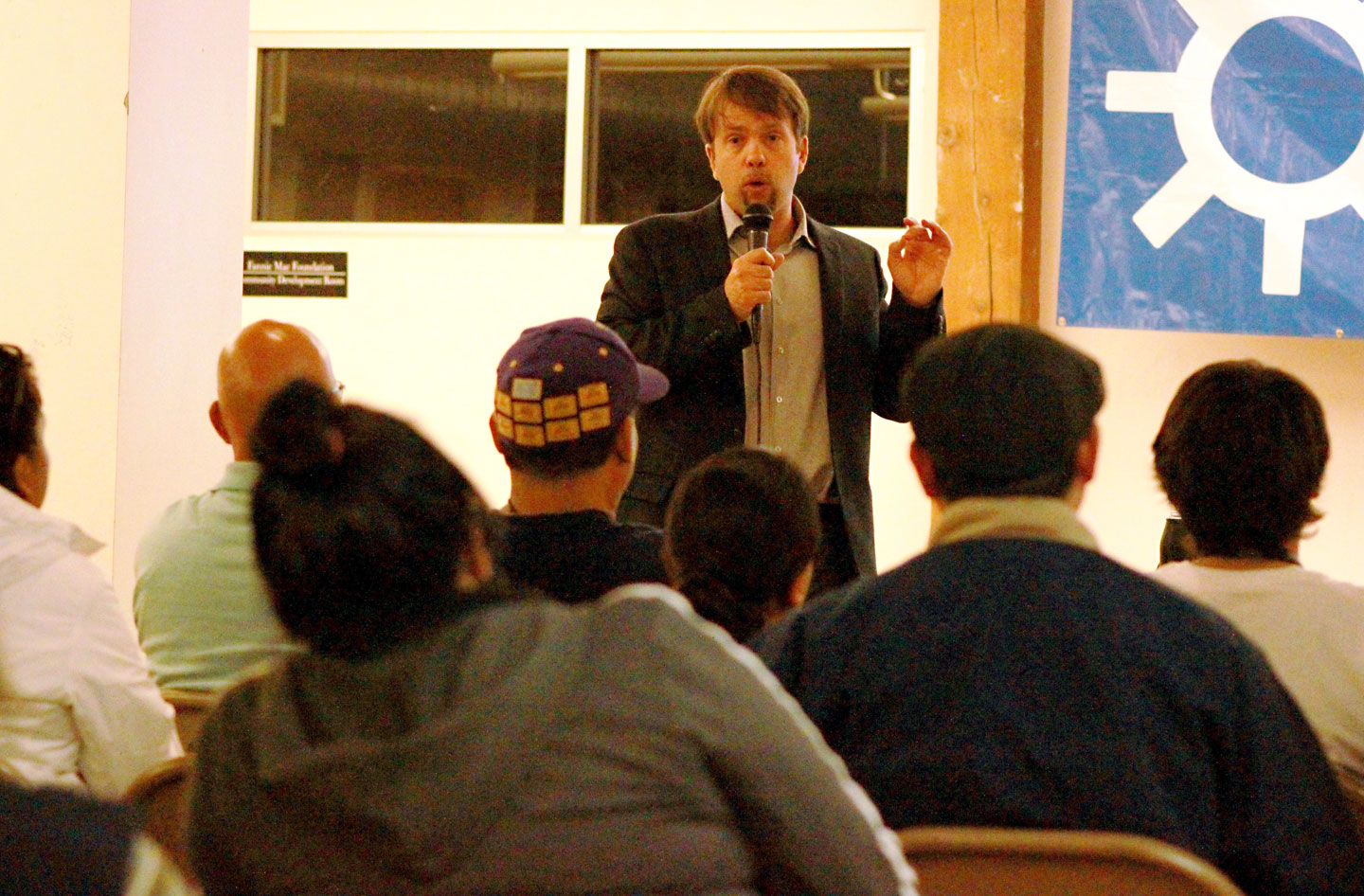 Central American Resource Center legal director Daniel Sharp leads a workshop aimed at educating immigrants about President Obama's recent executive action.