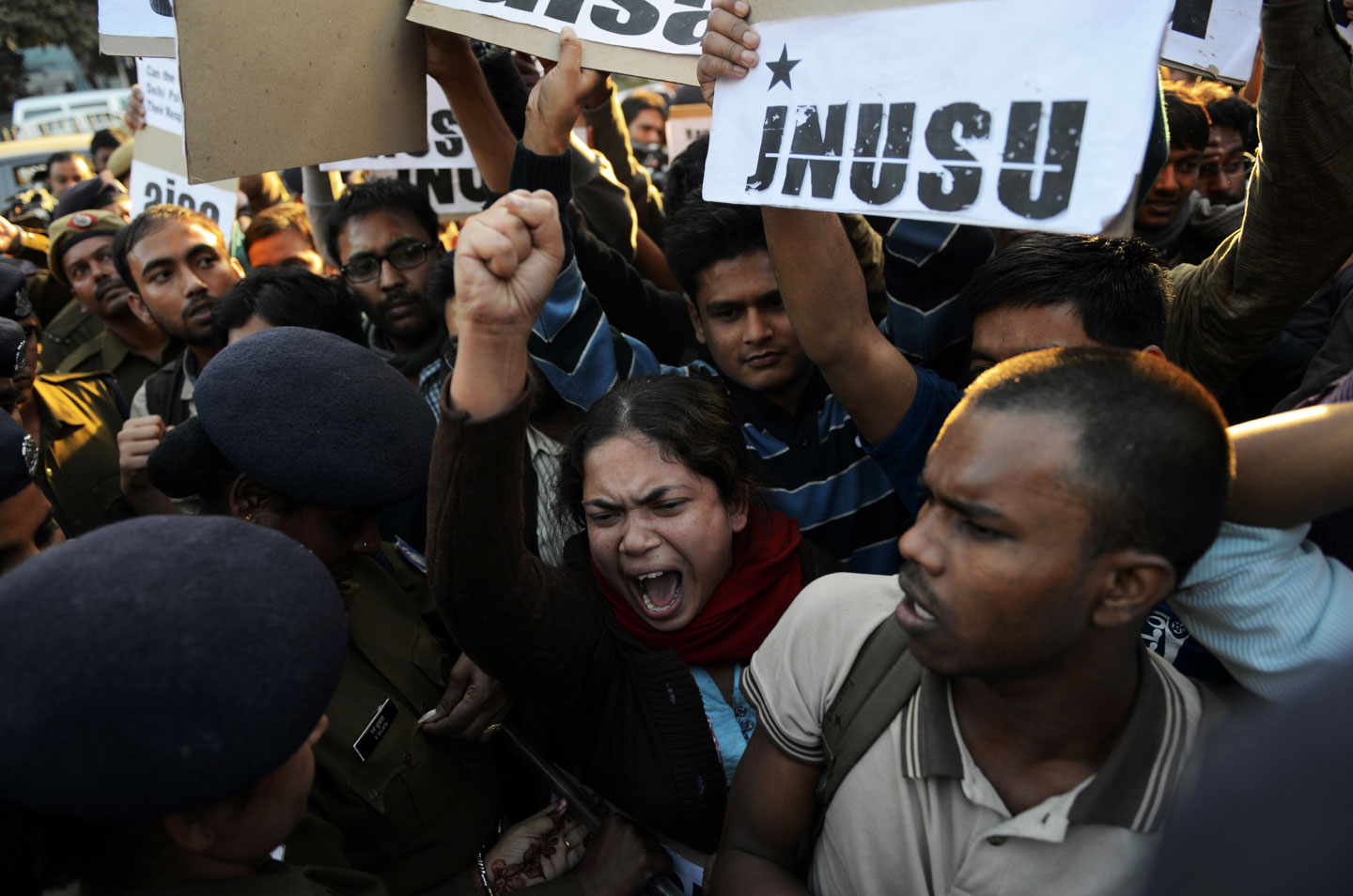 New Delhi residents take part in a protest against the alleged rape of a passenger by an Uber driver on December 7, 2014.