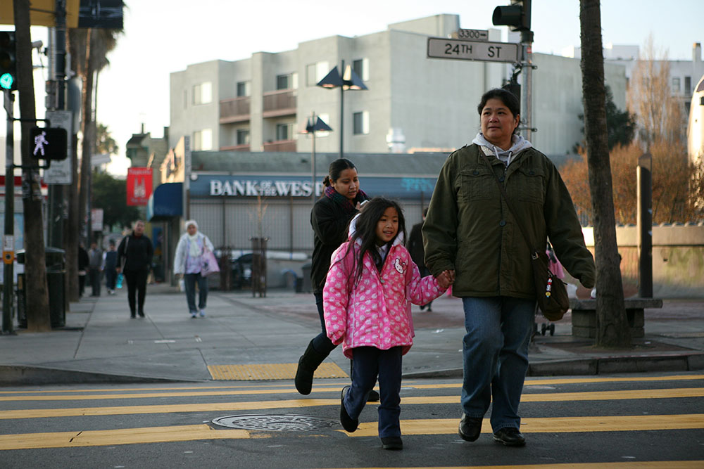 Rosario Bolos walks with her daughter Jessica, 6, to Cesar Chavez Elementary school in the Mission.
