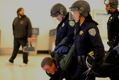 Police arrested a protester at the Montgomery Street BART Station around 7:30 a.m. Friday.