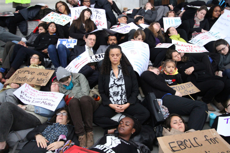 """Members of the Bay Area legal community gathered outside the California Supreme Court on Friday morning. For 15 minutes attorneys, legal staff, law students and allies lay silently on the steps of the courthouse in a """"Die-In"""" to advocate for racial justice."""