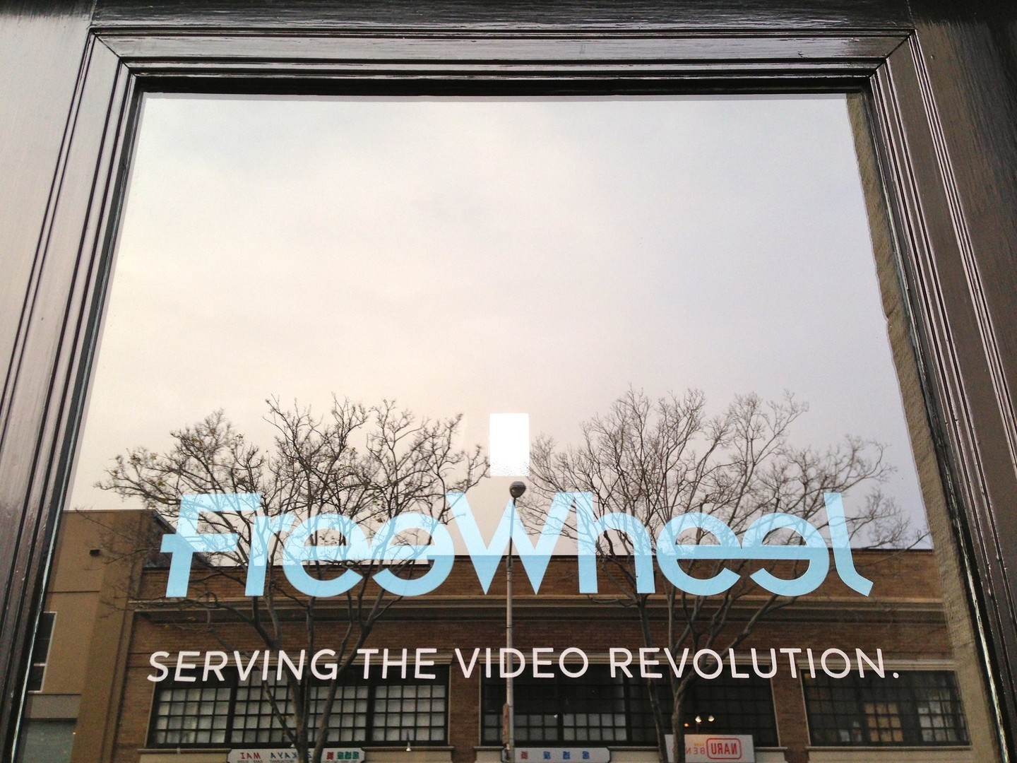 Many of downtown San Mateo's older office buildings now house tech start ups and restaurants. FreeWheel is in a 1925 Greek Revival that used to be a bank. In the window's reflection you can see another 1925 building across the street that's home to several Japanese restaurants.