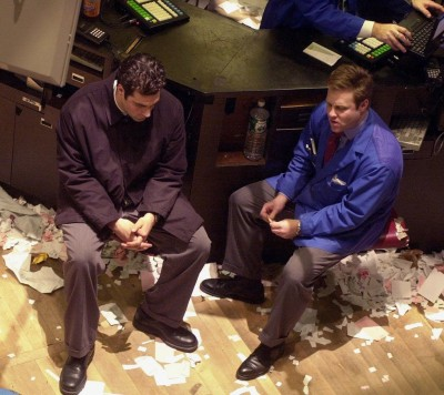 Traders wait on the floor of the New York Stock Exchange after the close of trading 04 January, 2000. The Dow Jones closed down 355.86 points (3.13 percent), and the NASDAQ composite was down 229.76 points (5.56 percent).