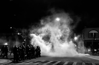 Police used smoke, tear gas and other tactics Dec. 6 to clear crowds they said were at times violent and aggressive. (Pete Rosos/Berkeleyside)