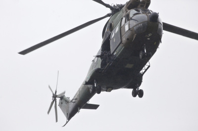 Armed security forces fly overhead in a military helicopter in Dammartin-en-Goele, northeast of Paris, on Friday.