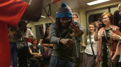 Byron Sanders, aka T7, a member of the Turf Feinz, performs on a BART train. (Adam Grossberg/KQED)