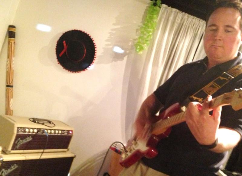 Riverside dentist Mark Harris plays on some treasured Fender gear in his basement rehearsal space.