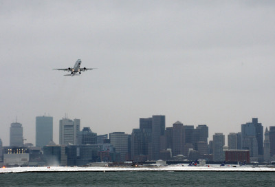 A flight takes off from Logan International Airport in Boston ahead of a massive storm expected to hit the region Monday afternoon, Jan. 26, 2015.