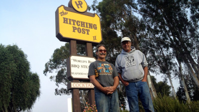 "Hitching Post partners Frank Ostini and Gray Hartley pose in the spot where thousands of tourists have snapped pictures since ""Sideways"" was released in 2004."