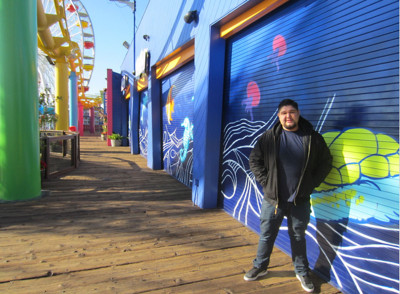 Bobby Rodriguez used to do illegal graffiti all over Southern California. With the help of Streetcraft L.A., he now gets legal work, like this mural on the Santa Monica pier.