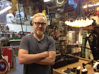 "Adam Savage, co-host of ""Myth Busters,"" in his ""cave."""