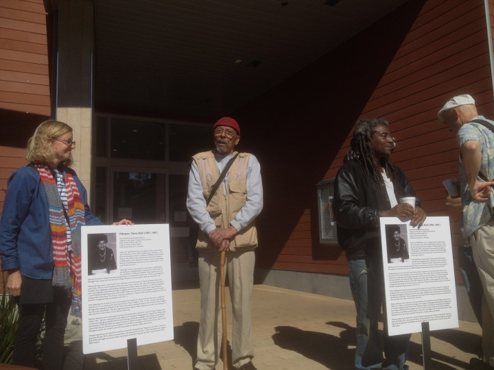 Charles Austin (center) stands in front of the South Branch Library.