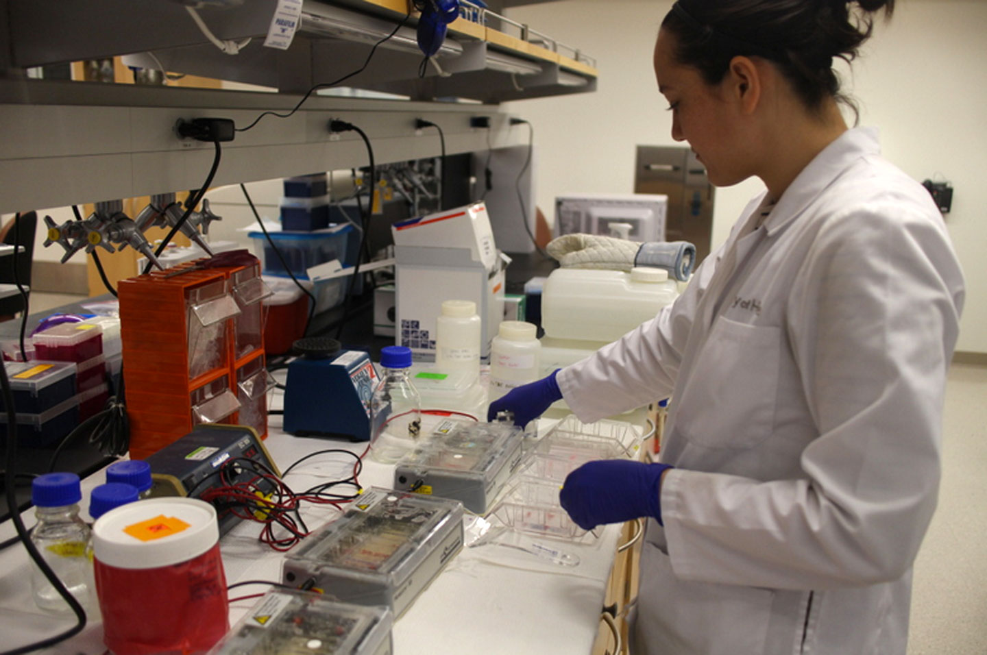 Research associate Sarah Wright uses a machine to help separate out different strands of DNA at a lab at City of Hope in Duarte, California.