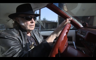 Neil Young behind the wheel of his Cadillac El Dorado outfitted with a PonoPlayer.