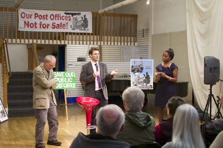 At a meeting held in Berkeley on Feb. 19, Antonio Rossmann, Brian Turner and Moni Law (l to r) address a crowd gathered to discuss the proposed sale of the downtown Berkeley Post Office.
