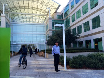 Prominent local Silicon Valley developer John M. Sobrato standing in front of the Apple headquarters he built in Cupertino in 1992.