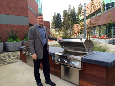 Phil Mahoney, executive vice president of Cornish & Carey in Santa Clara shows off the new grill at an old research and development building in North San Jose. It is one of many buildings being modified to make it marketable again.