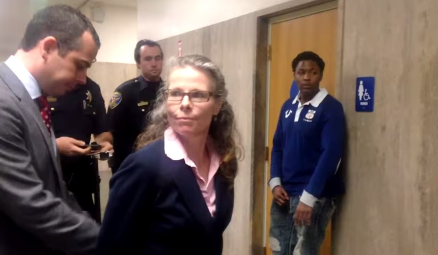 A screen shot from a video showing San Francisco police Sgt. Brian Stansbury arresting deputy public defender Jami Tillotson outside a courtroom on Jan. 27, 2015.
