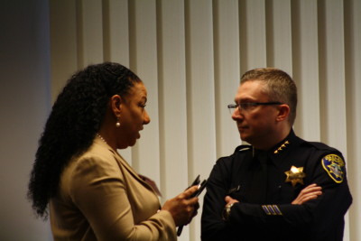 Olis Simmons, founder and CEO of Youth UpRising, speaks to Oakland Police Chief Sean Whent Feb. 5, 2015, before a roundtable discussion convened by U.S. Attorney General Eric Holder.