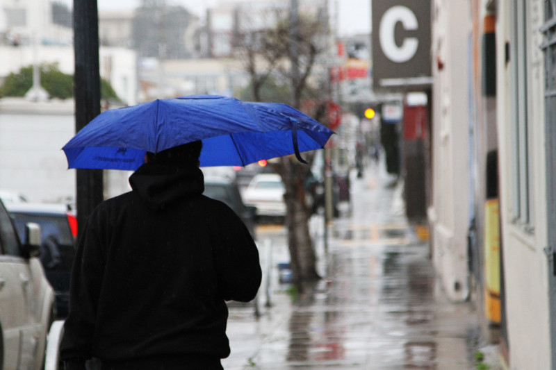 The Bay Area is expecting a windy storm early in February. Rain began to fall Friday morning in San Francisco's Mission District. (Anya Schultz/KQED)