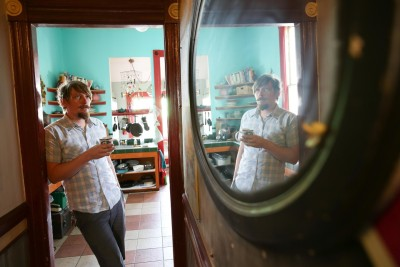 Shalaco Shing, a photographer, has lived at the Merry-Go-Round House; since 2009. (Jeremy Raff/KQED)