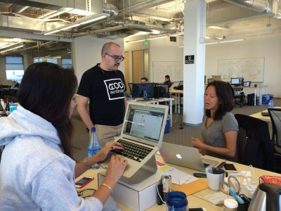 Dave McClure, founding partner of the tech incubator 500 Startups talks with staff members after a new batch of entrepreneurs arrive in his San Francisco office. 500 Startups has offices in Mountain View, San Francisco and Mexico City.