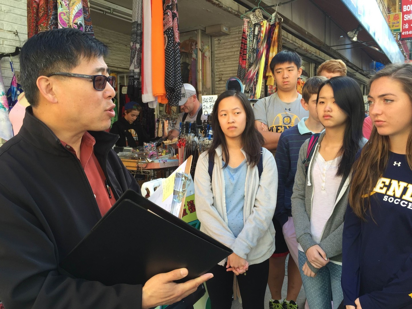 The Chinese Culture Center of San Francisco's director of education and engagement, Darin Ow-Wing (left), gives a tour of Chinatown on Feb. 12, 2015.
