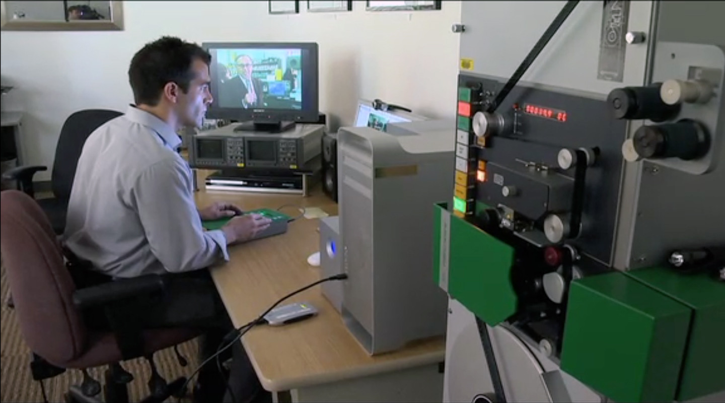 SF State film archivist Alex Cherian pictured in a 2011 short film produced by KPIX. (SF Bay Area TV Archive)
