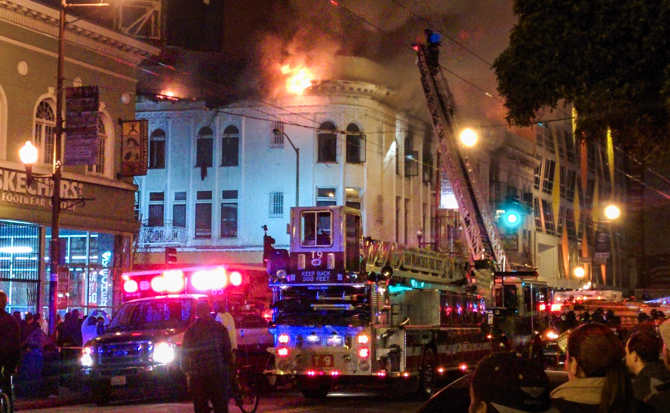 San Francisco firefighters battle a four-alarm blaze in a mixed residential and commercial building at 22nd and Mission streets on Jan. 28, 2015. One person died and more than 60 others were displaced by the fire.  Rebecca Bowe/KQED