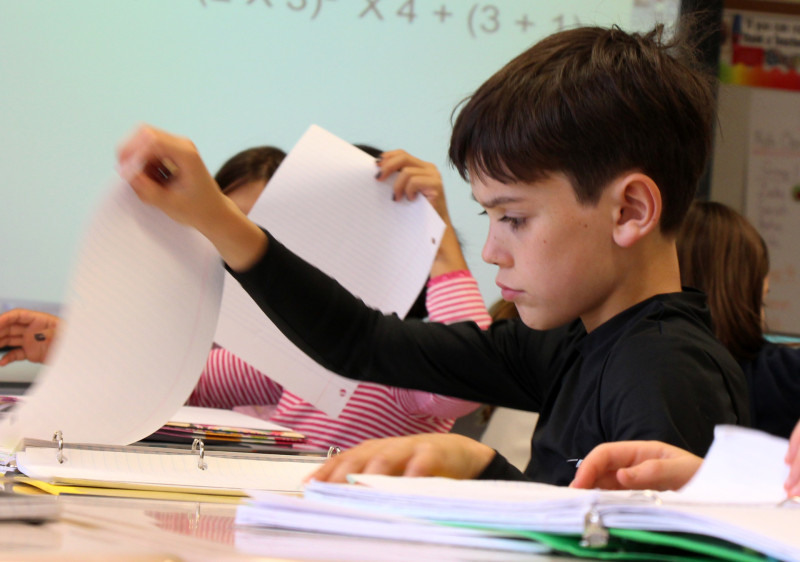 Students studying math problems.