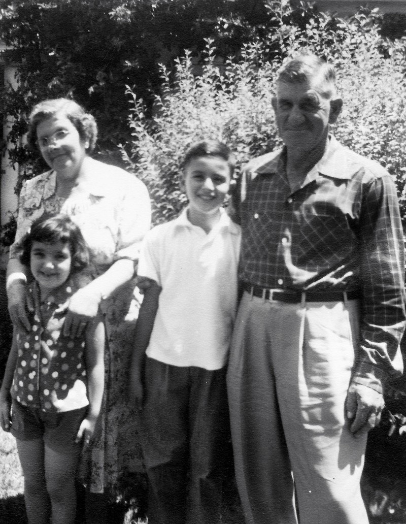 Charles Amirkhanian at age 9 with his sister and maternal grandparents. The photo is from 1954