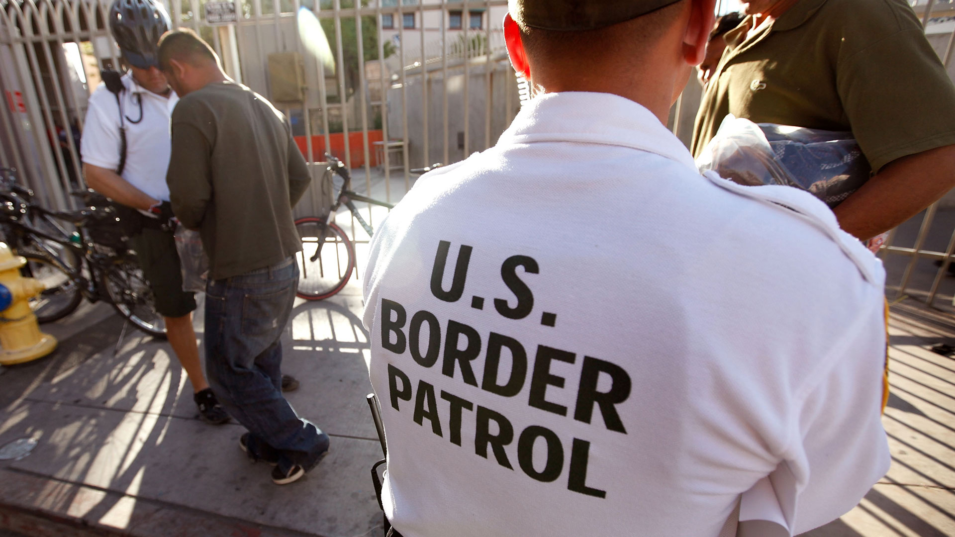 U.S. Customs and Border Protection patrol agents assist undocumented Mexicans being returned to Mexico.