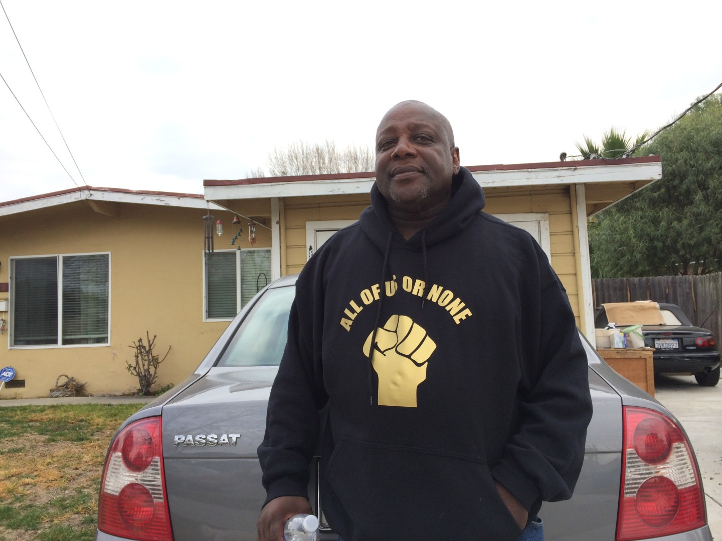 Dorsey Nunn stands in front of his house in Belle Haven on Jan. 16, 2015. Nunn's parents purchased the property in 1968. He estimates the three-bedroom house is now worth over $570,000, in part thanks to its proximity to Facebook.