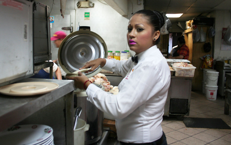 A waitress in the back of the house at El Dragon restaurant in Mexicali.