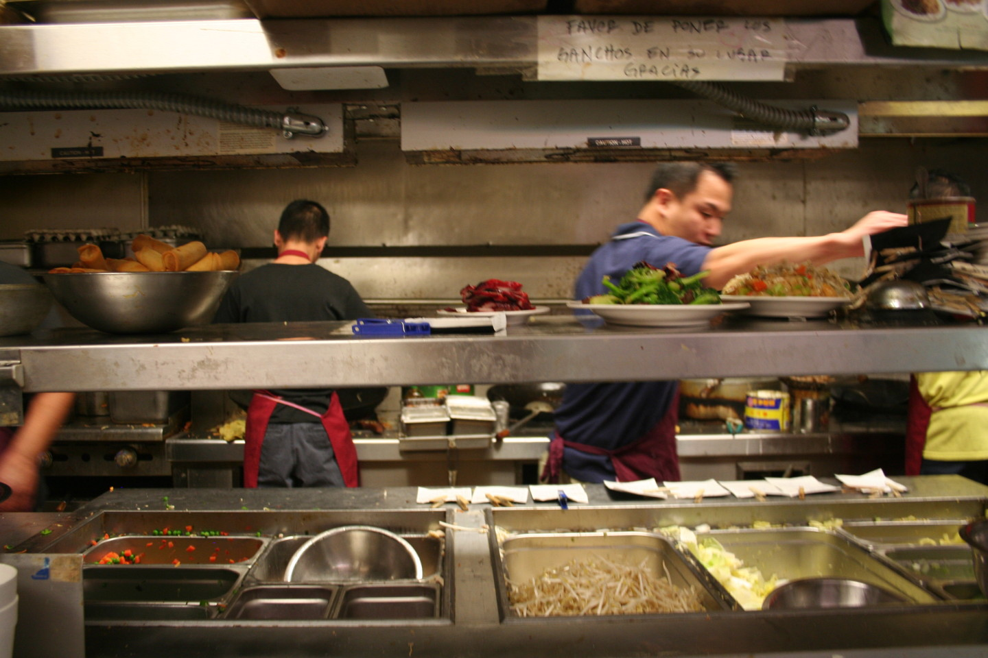 In the Fortune Garden kitchen, chefs speak to each other in Cantonese, and waiters give orders in Spanish. Vickie Ly/KQED