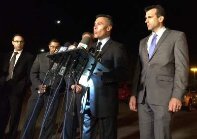 San Jose Police Chief Larry Esquivel, center, and Mayor Sam Liccardo, right, at Tuesday night press conference on fatal shooting of police officer.